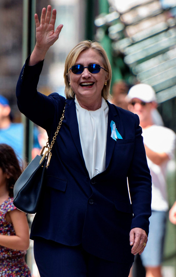 Upbeat: Hillary Clinton waves off her health scare
