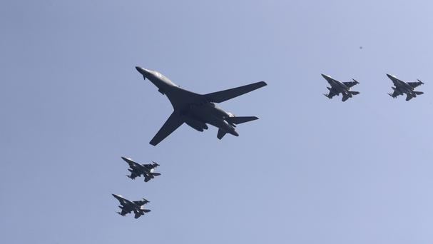 The US B-1 bomber flies over Osan Air Base accompanied by US jets (AP)