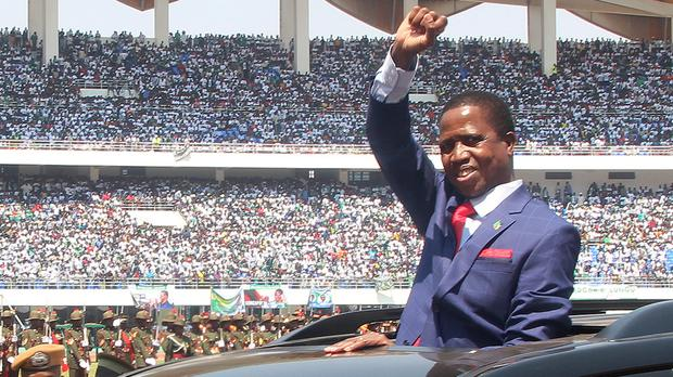 President Edgar Lungu of Zambia, waves to the crowd during his inauguration in Lusaka (AP)