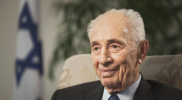 Former Israeli president Shimon Peres was rushed to hospital (AP)