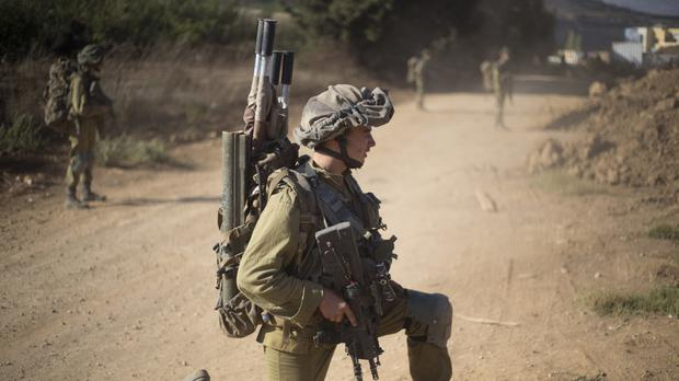 Israeli soldiers of the Golani brigade take position during training in the Israeli-controlled Golan Heights (AP)