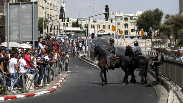 Israeli police officers on horseback stand guard near the scene of an attack at the Damascus gate in Jerusalem's Old City on Friday (AP)