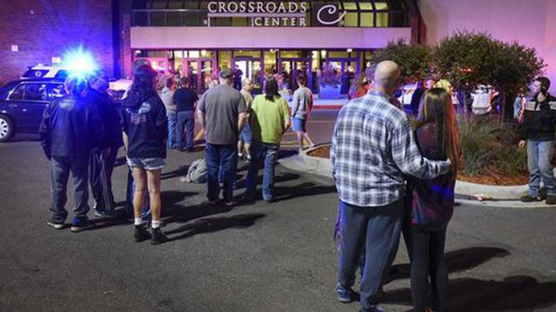 People outside the Minnesota mall where multiple people were injured in a stabbing incident (St Cloud Times/AP)