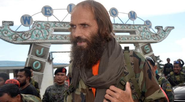 Released Norwegian hostage Kjartan Sekkingstad carries a backpack as he boards a plane to take him to Davao city (AP)