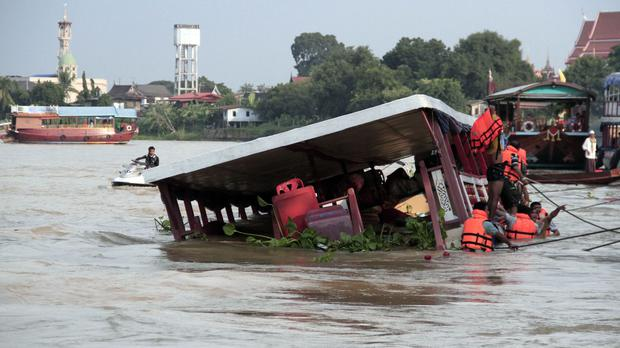 Thai rescue teams search for victims (Dailynews via AP)