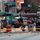 FBI agents examine the scene of the bombing in Manhattan's Chelsea area