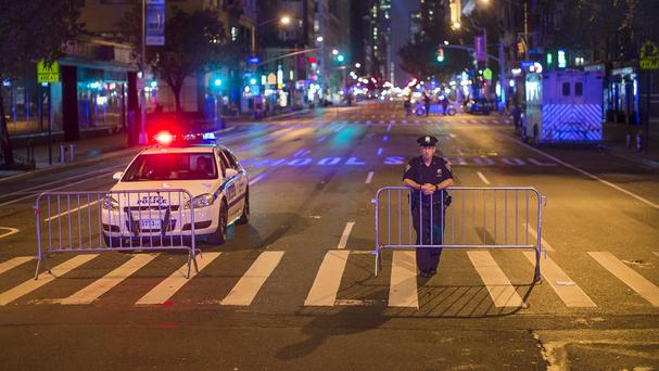 Police stand guard near the scene of the explosion (AP)