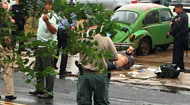 Ahmad Khan Rahami is taken into custody after a shoot-out with police