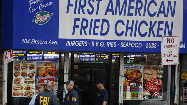 FBI agents searched an apartment above the family's fried chicken shop in Elizabeth, New Jersey (AP)