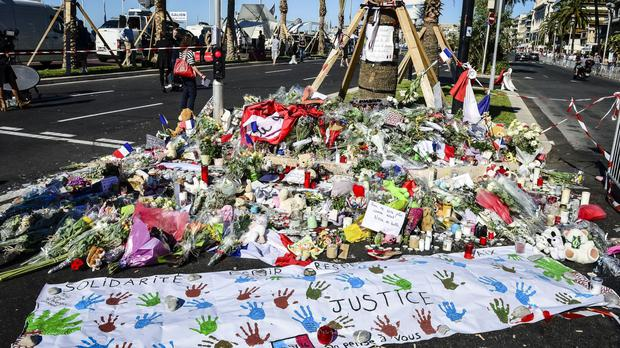 Tributes on the Promenade des Anglais, Nice, where 84 people died after the lorry was deliberately driven into Bastille Day revellers