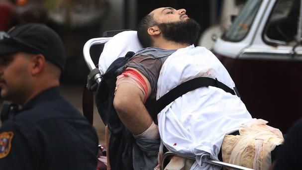 Ahmad Khan Rahami is taken into custody after the shoot-out with police in Linden, New Jersey (NJ Advance Media/AP)