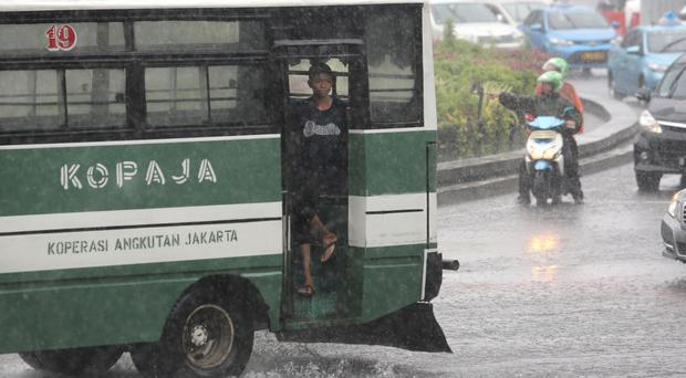 Heavy rain hits the main business district in Jakarta, Indonesia (AP)