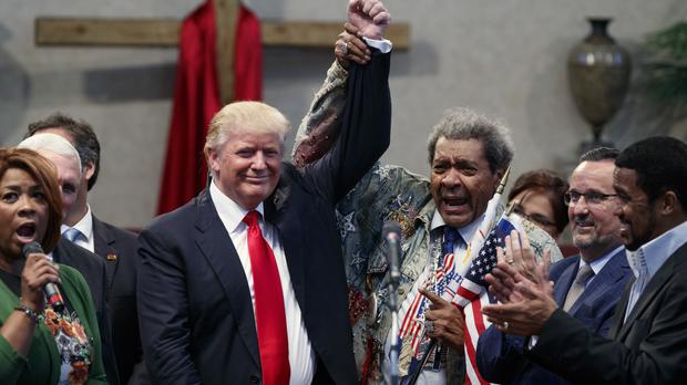 US presidential candidate Donald Trump meets boxing promoter Don King at the New Spirit Revival Centre in Cleveland, Ohio (AP)
