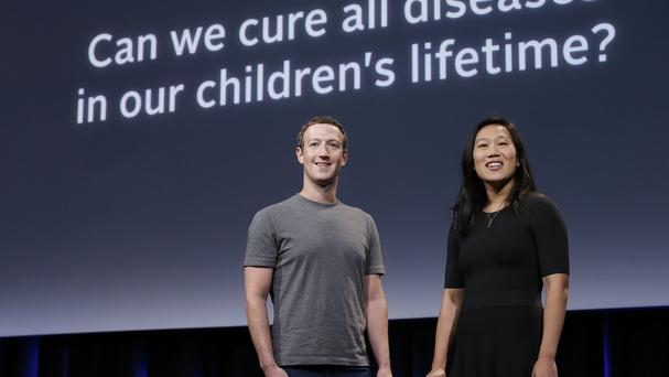 Facebook chief executive Mark Zuckerberg, left, smiles next to his wife Priscilla Chan as they rehearse for a speech in San Francisco (AP)