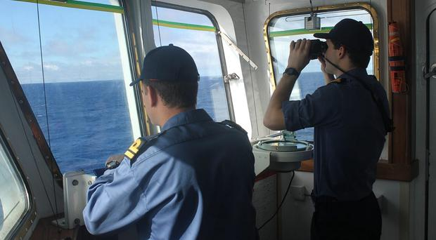 The crew on board survey ship HMS Echo in the southern Indian Ocean helps in the underwater search for the flight recorder from the missing Malaysia Airlines flight MH370 (MoD/PA)