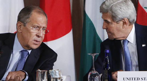 Russia's foreign ninister Sergey Lavrov, left, and US secretary of state John Kerry have failed to revive the Syria ceasefire. (AP)