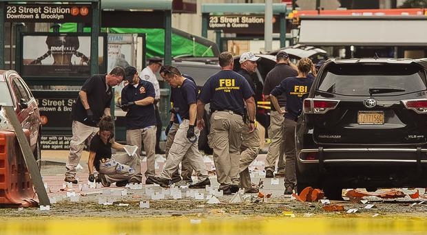 FBI staff examine the scene of Saturday's explosion in Manhattan's Chelsea neighbourhood (AP)