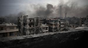 Smoke rises over Aleppo as pro-government forces continue their intense bombardment