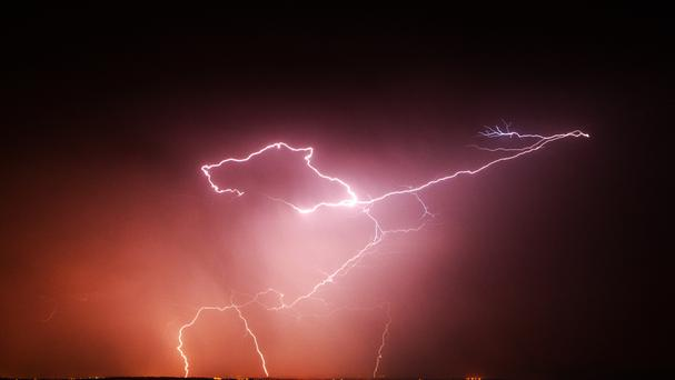 A frightened passenger on a plane struck by lightning on the way into Belfast has told of her terror. File image