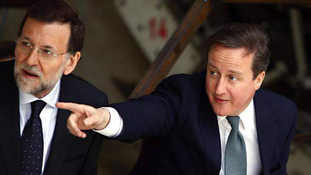 Mr Rajoy, left, pictured with then prime minister David Cameron, has been running a caretaker government for almost a year