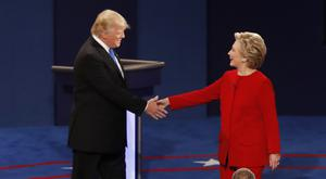 Democratic presidential nominee Hillary Clinton shakes hands with Republican presidential nominee Donald Trump at the start of the presidential debate (AP)