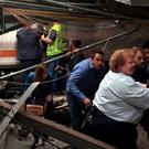 Passengers rush to safety after a train crashed in to the platform at the Hoboken Terminal in New Jersey