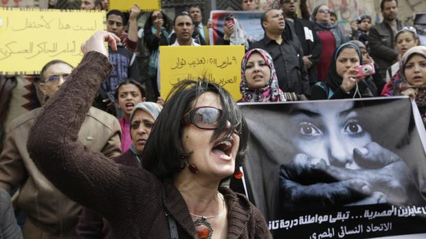 An Egyptian activist shouts anti-military Supreme Council slogans during a demonstration in front of Cairo's high court (AP)