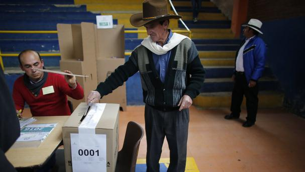 A man casts his ballot during the referendum on a peace deal with Colombian rebels (AP)