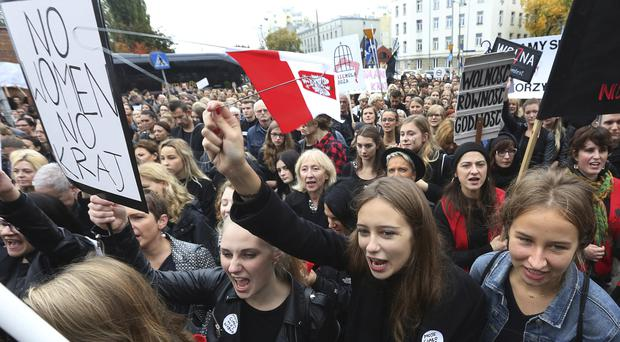 Polish women shout slogans during a nationwide strike to protest against a legislative proposal for a total ban on abortion (AP)