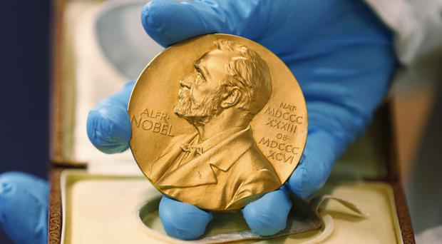 David Thouless, Duncan Haldane and Michael Kosterlitz won the Nobel Prize in physics (AP)