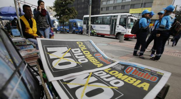 Newspapers headlines reading Colombia Said No reflect the shock result of the peace deal referendum (AP)