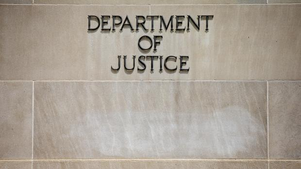 The Justice Department announced a criminal complaint against a US federal government contractor (AP)