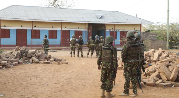 Soldiers guard the residential building in Mandera, northern Kenya, after an attack by suspected Islamic extremists (AP)