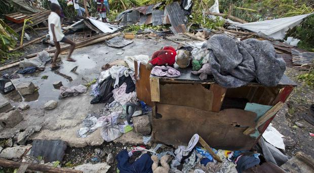 Personal items lie scattered outside homes destroyed by Hurricane Matthew in Les Cayes (AP)