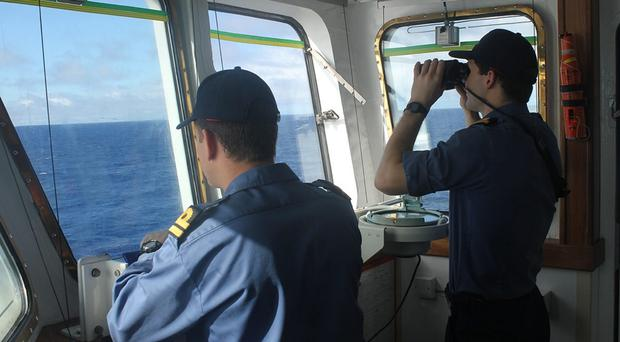 The crew of survey ship HMS Echo help in the underwater search for the flight recorder from the missing Malaysia Airlines flight MH370 (MoD/PA)
