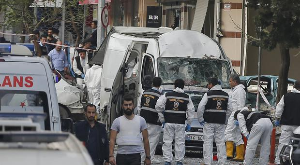 Police at the scene of a motorcycle bomb blast in Istanbul, Turkey (AP)