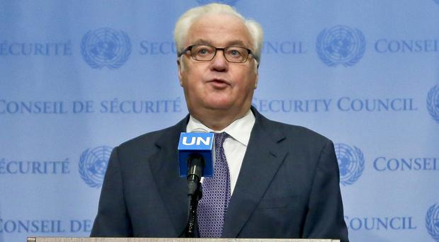 UN ambassador Vitaly Churkin is likely to veto a bid to ground Russian warplanes (AP)