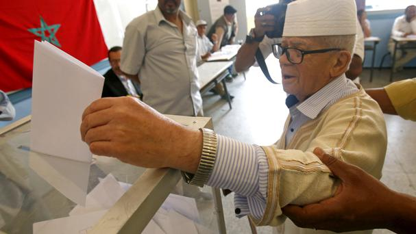 Voters cast their ballots at a polling station in Rabat (AP)