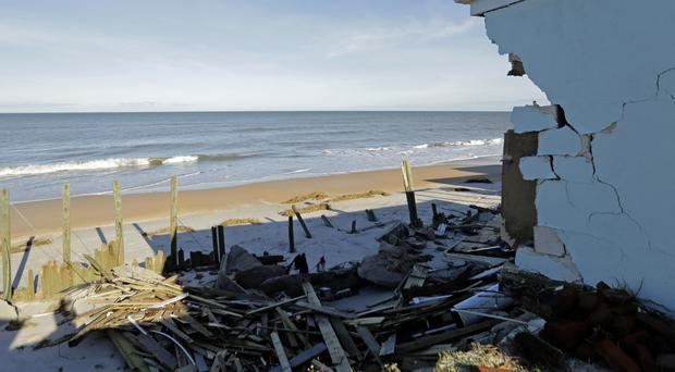 The remains of a sea wall stand beyond a destroyed home at Ponte Vedra Beach, Florida (AP)