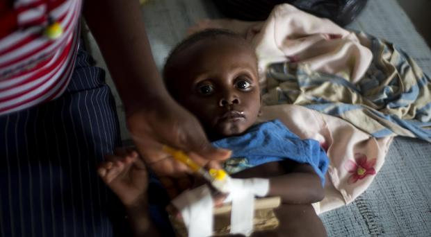 Cholera victim Cenelson Lundi, aged just 13 months, receives treatment at the state hospital in Jeremie, Haiti (AP)