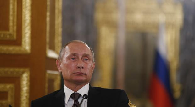 Vladimir Putin has delayed his visit to France (AP Photo/Emrah Gurel)
