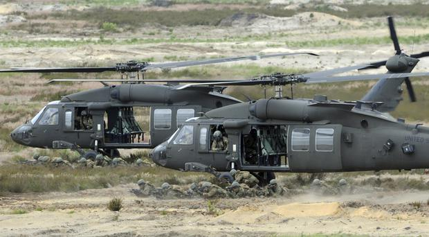 Polish leaders say the country is buying Polish-made Black Hawk helicopters as it modernises its army. (AP)