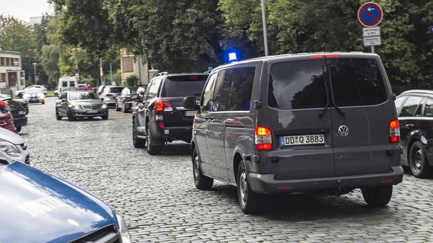 Police vehicles outside the district court in Dresden, eastern Germany (AP)