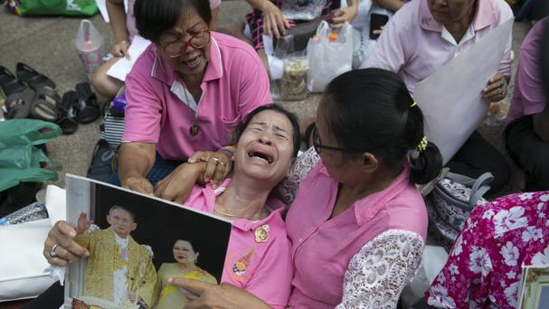 Thais pray for King Bhumibol Adulyadej at Siriraj Hospital where he is being treated in Bangkok (AP)