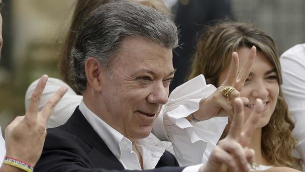 Juan Manuel Santos is extending the ceasefire with the Revolutionary Armed Forces of Colombia until December 31 (AP)