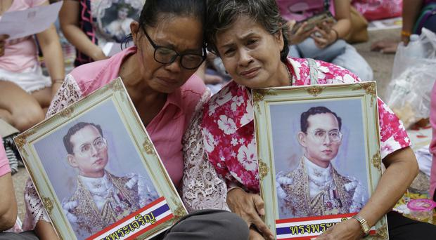 Thais remember King Bhumibol Adulyadej at Siriraj Hospital, Bangkok (AP)