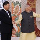 Indian prime minister Narendra Modi, right, welcomes Chinese president Xi Jinping (AP)