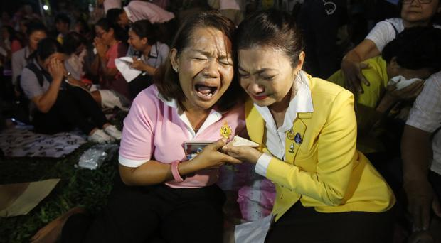 Thais cry outside Siriraj Hospital where King Bhumibol Adulyadej was treated in Bangkok (AP)