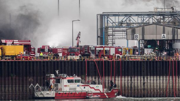 Fire crews at the site of the blaze at the BASF plant site in Ludwigshafen, Germany (Frank Rumpenhorst/dpa via AP)