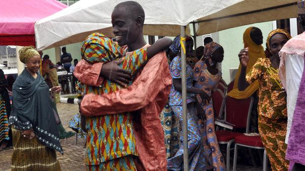 One of the kidnapped girls celebrates with a family member during an church service held in Abuja, Nigeria (AP)